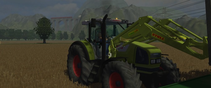 Claas Ares 826 mit Frontlader